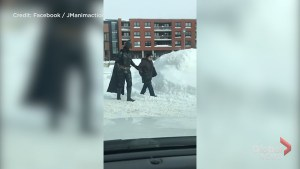 Batman helps Montrealers dig out after winter storm