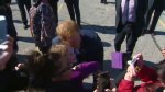 Prince Harry greets fans waiting outside Queen's Park