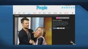 "Duhamel and Liza Fromer's ""awkward Travolta touch"" goes viral"