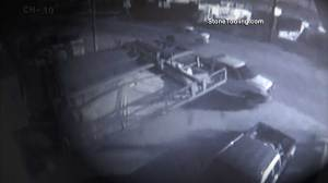 Driver narrowly escapes collapsing billboard