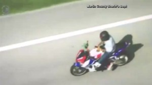 Man on motorcycle takes both hands off handlebars to text during high-speed chase