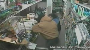 Dramatic video shows store clerk fighting off two armed robbers