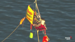 Activists hang from bridge in Portland, Ore., to block Shell oil icebreaker