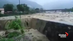 Monsoon rains burst flood wall as Nepalese sent fleeing