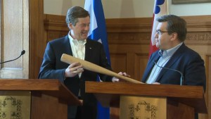 Tory and Montreal's Mayor exchange sports memorabilia during visit