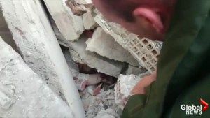 Rescue worker comforts elderly woman left buried by earthquake in Italy