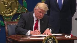 Trump signs 'executive actions' to rebuild armed services, keep 'terrorists out'