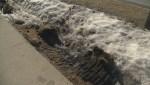 Broken cement, torn up grass left behind by Winnipeg snowplows over the winter