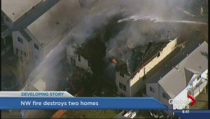 Massive fire destroys two homes