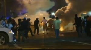 Another night of clashes in Ferguson