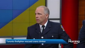 Heroic firefighter speaks out about 'crane girl' rescue