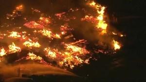 Inferno engulfs California wooden pallet storage yard