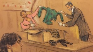 Boston bomber jury sees gruesome autopsy photos as prosecution rests case
