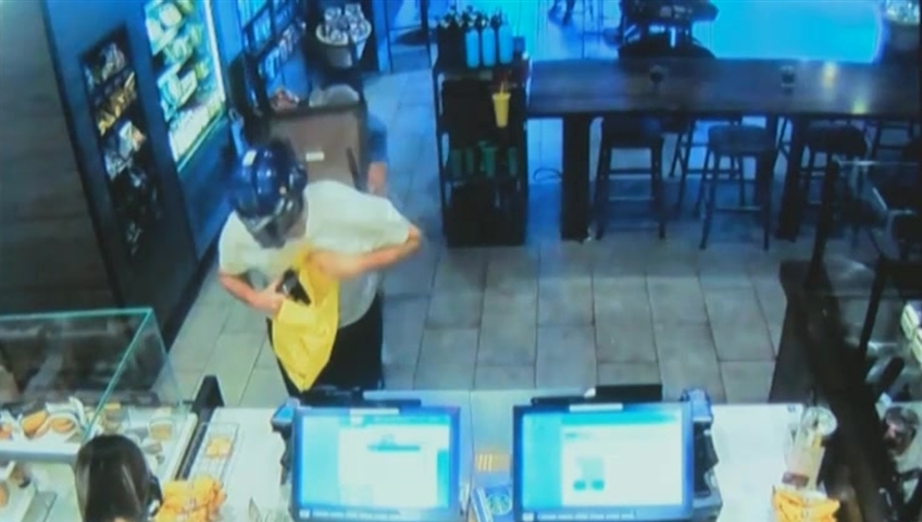 Old customer takes down armed robber with a steel chair