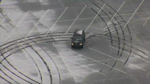 RAW: Texas driver does donuts in empty parking lot