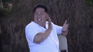 New footage shows Kim Jong Un applauding missile launches
