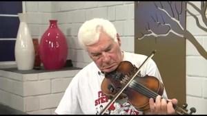 Wally Potoliki and his flea-market-find Josef Guarnerius violin.