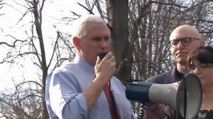Vice President Pence helps volunteers clean up vandalized Jewish cemetery