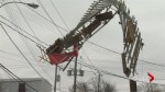 Crane load contacts power lines, hundreds left without power.
