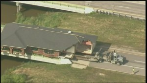 House breaks, large piece falls to ground during highway move