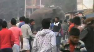 Wild elephant runs amok in east Indian town, smashing homes