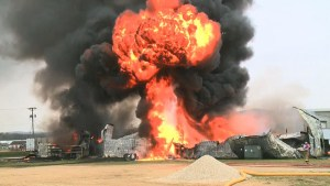 Massive fire at oil refinery in Iowa injures firefighter