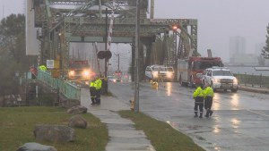 Toronto police searching for driver after car plunges off bridge