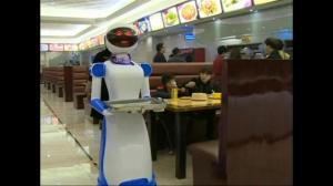 Chinese restaurant unveils robotic waiters