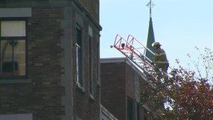 Aftermath footage of firefighters responding to Montreal building fire