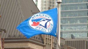 Mayor John Tory raises Blue Jays flag at city hall