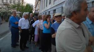 Raw video: Thousands line up as banks temporarily reopen in Greece