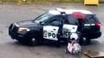 Police officer uses cruiser as bus shelter for woman and child caught in rain