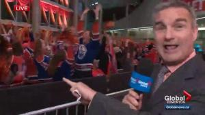 Sports reporter Kevin Karius live hit interrupted by Edmonton Oilers winning goal