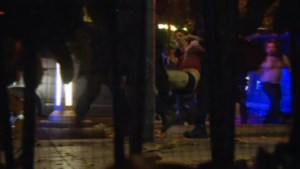 Raw video: Survivor with ripped clothing carried away from Bataclan theatre by police