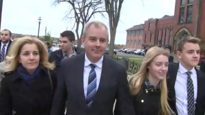 Dennis Oland leaves court after being granted bail
