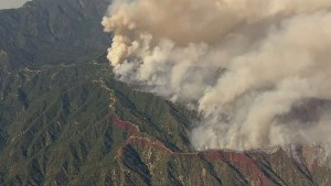 Extreme heat wave complicating wildfire battles in western U.S. states.