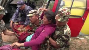 Injured, aid unloaded from helicopter in Nepal