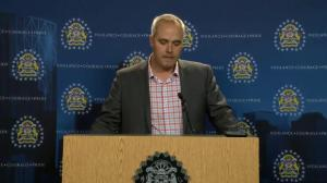 Calgary police announce charges against a man for the murder of father