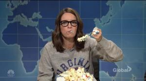 Tina Fey takes out frustration with Trump and Charlottesville by devouring American flag cake