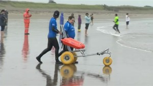 People with disabilities learn how to surf in Nova Scotia