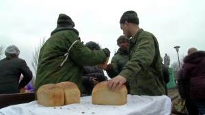 Russian-backed rebels hand out food in Ukraine