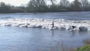 Extreme high tide in the Britain welcomed by surfers