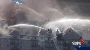 Firefighters battle a massive condo blaze