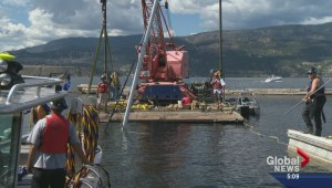 Divers retrieve Kelowna Yacht Club's sunken sailboat