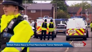 13 people under arrest after Manchester attack, but UK official warns there could be more at large