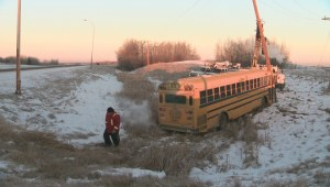Power company employees help bus crash passengers