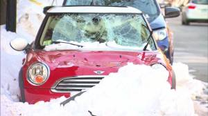 Melting ice, snow crushing parked cars in Boston