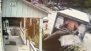 Delivery truck rolls down street causing havoc