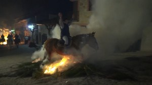 Spanish town criticized for tradition of horses and riders jumping through bonfires