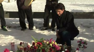 Prime Minister Justin Trudeau lays flowers outside La Loche school, site of tragic shooting